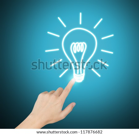 hand pointing at electric light bulb