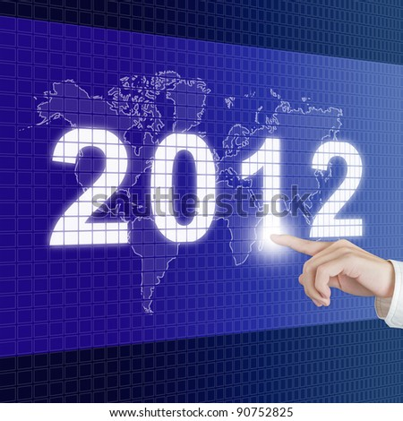hand pointing new year 2012 with world map on digital board