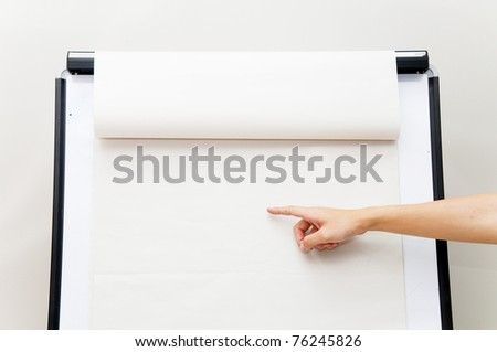 hand pointing on flip chart
