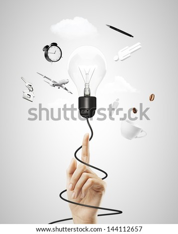 hand pointing on lamp with cable, travel concept