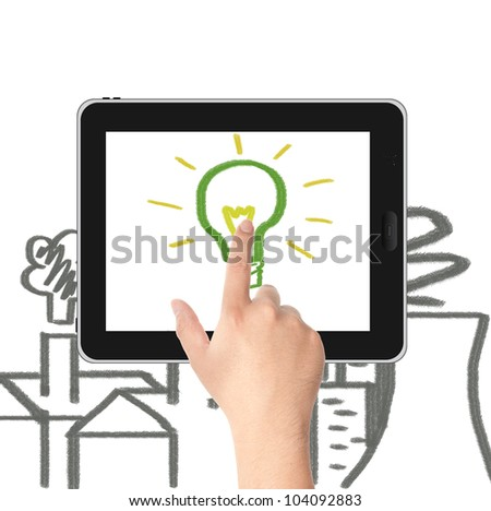 Hand pointing to the hand draw green light bulb on tablet PC screen with factories and Nuclear plant pollution. Concept for eco and global warming