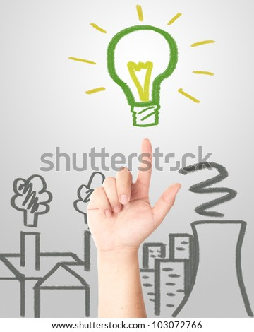 Hand pointing to the hand draw green light bulb with factories and Nuclear plant pollution. Concept for eco and global warming