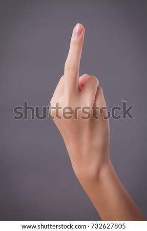 hand pointing up middle finger, concept of rude hand sign or hand gesture, studio isolated #732627805