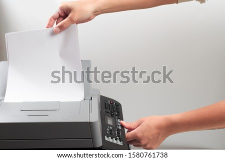Hand press button on panel of printer. printer scanner laser office copy machine supplies start concept. Reply, 2 pages, pause, 2in 1 passport , fax, options, wifi, copy, scan, print, stop, start #1580761738