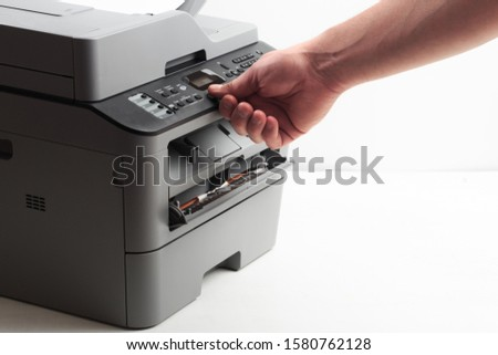 Hand press button on panel of printer. printer scanner laser office copy machine supplies start concept. Reply, 2 pages, pause, 2in 1 passport , fax, options, wifi, copy, scan, print, stop, start #1580762128