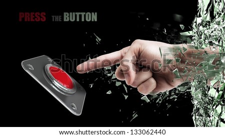 Hand press on big Red button out of cracked glass isolated on black background