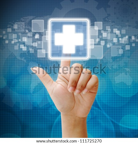 Hand press on First Aid icon - stock photo