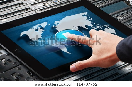 Hand press on power button on world map from digital tablet