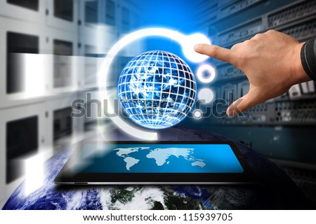 Hand press on system control in server room : Elements of this image furnished by NASA