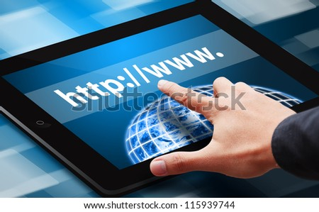 Hand press on web link on tablet : Elements of this image furnished by NASA