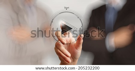 hand press play button sign to start or initiate projects as concept