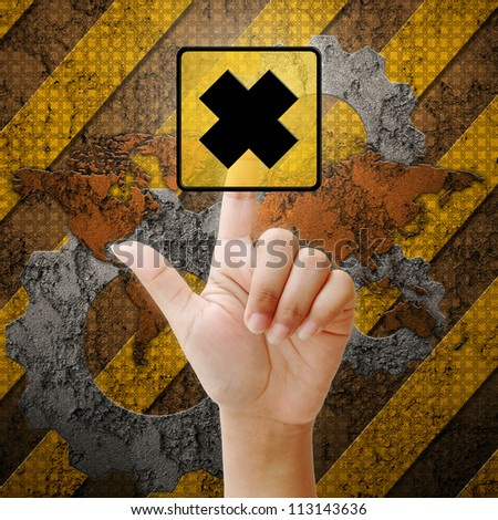 Hand press touch cross mark symbol on industry background