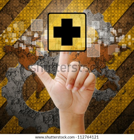 Hand press touch First Aid symbol on industry background
