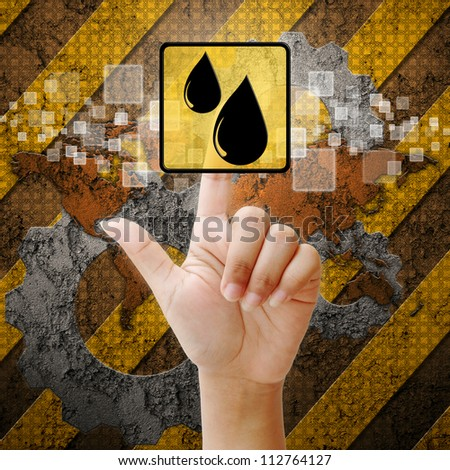 Hand press touch oil symbol on industry background