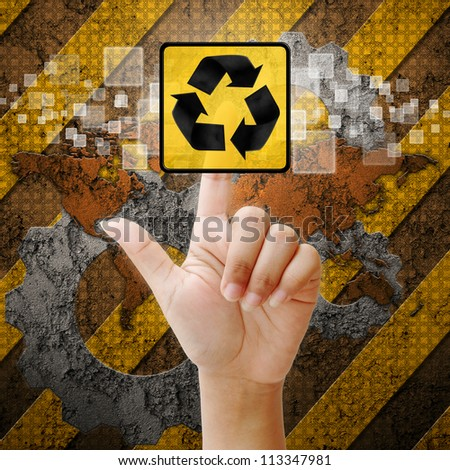 Hand press touch Recycle symbol on industry background