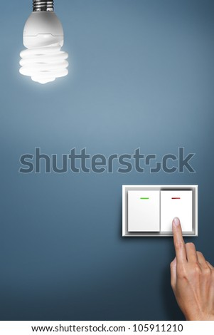 hand pressed to switch to turn off the light.