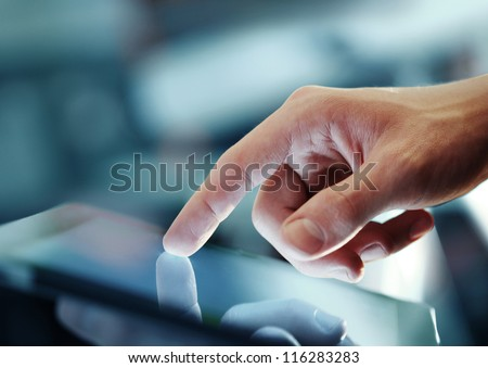 hand presses on screen digital tablet