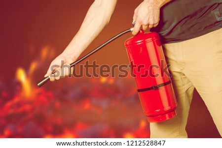 Hand presses the trigger fire extinguisher hand presses the trigger fire extinguisher