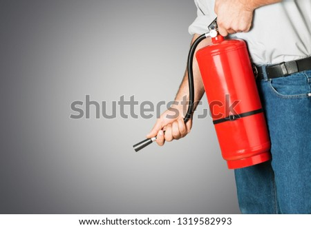 Hand presses the trigger fire extinguisher hand presses the trigger fire extinguisher #1319582993