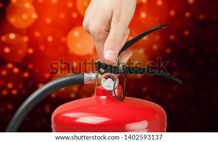 Hand presses the trigger fire extinguisher hand presses the trigger fire extinguisher #1402593137