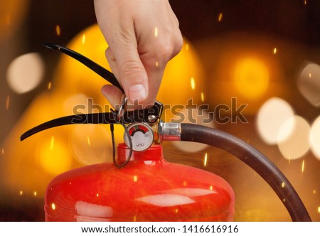 Hand presses the trigger fire extinguisher hand presses the trigger fire extinguisher #1416616916