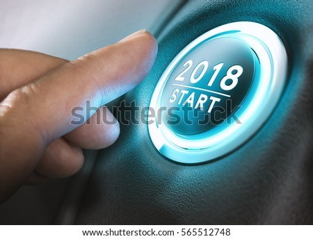 Hand pressing a 2018 start button. Concept of new year, two thousand eighteen. Composite between a photography and a 3D background. Horizontal image #565512748