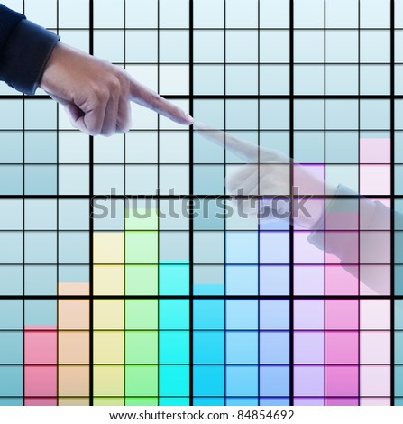 Hand pressing color graph ,reflect in the building