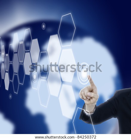 Hand pressing hexagon touch screen in space with blue world background