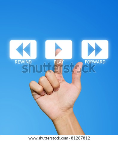 Hand pressing play button on the blue background