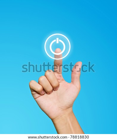 Hand pressing power button on blue background
