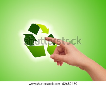 Hand pressing recycle icon on green gradient