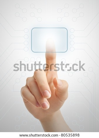 Hand pressing virtual button on futuristic holographic screen.