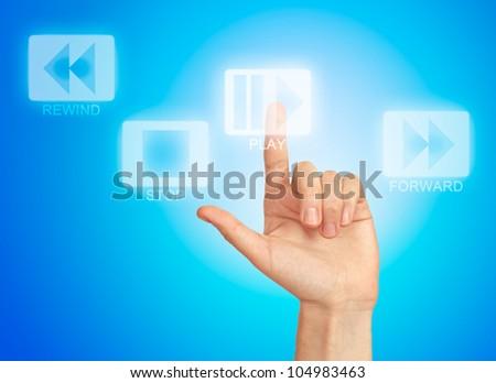 Hand pressing virtual button play