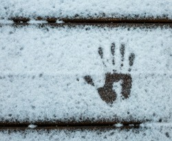Hand print on the snow
