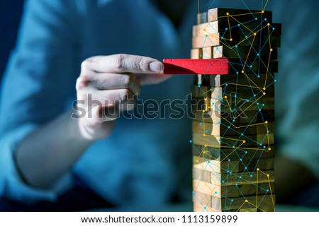 hand pull important color block from balance wooden stack business strategy and risk management control concept #1113159899