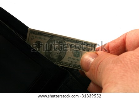 hand pulls miniature money out of a wallet representing the world financial crisis isolated on white