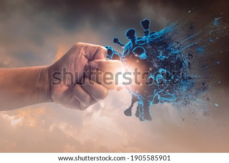 Hand punched fight attack to coronavirus,concept of fighting corona Virus or covid 19,exercise, health care, social distancing, innovations, vaccine and drug development, medicine and research. Foto stock ©
