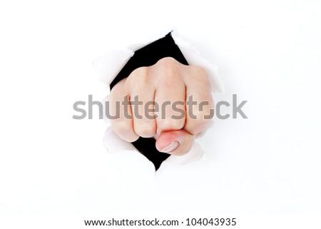 Hand punching through white paper