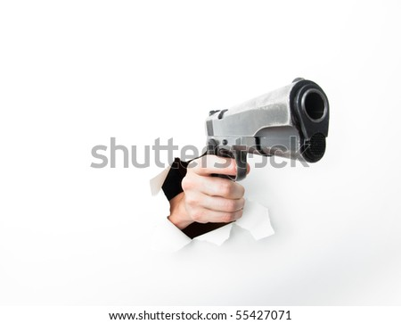 Hand punching through white paper with big semiautomatic pistol. Photographed with a fisheye lens for exaggerated perspective.
