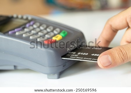 Hand Push Credit Card Into A Credit Card Machine : Selective Focus #250169596