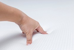 Hand push on orthopedic of para latex mattress bed for Softness test of rubber cushion.