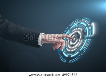 Hand pushing a button on a touch screen interface. Man pressing a touchscreen button