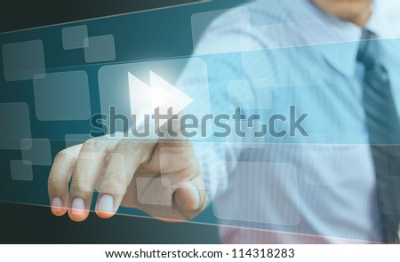 hand pushing a fast forward button on a touch screen interface