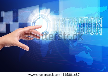 hand pushing a innovation button on touch screen interface, hi-technology