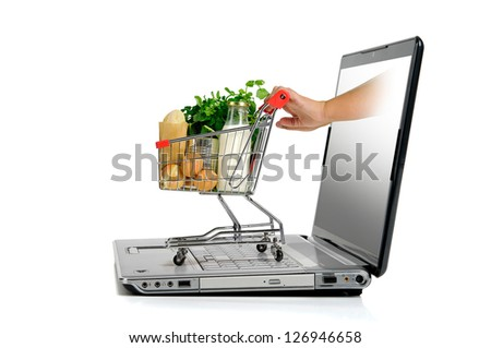 Hand pushing a small shopping cart from  laptop screen isolated in white
