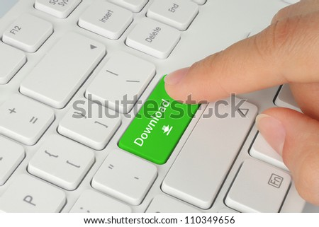 Hand pushing green download keyboard button