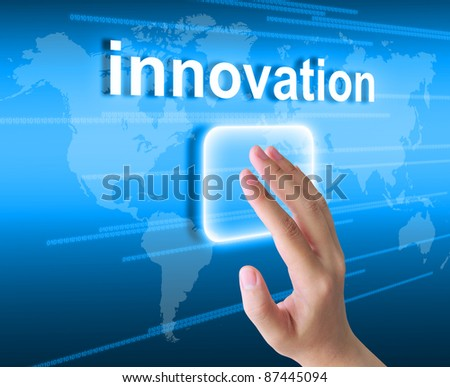 hand pushing innovation button on a touch screen interface