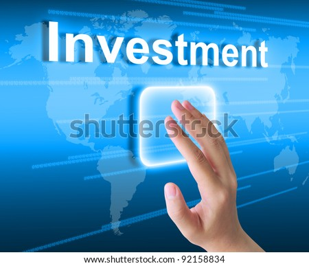 hand pushing investment button on a touch screen interface