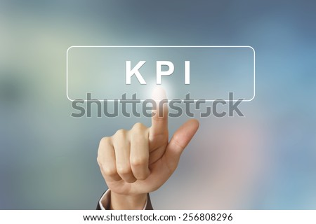 hand pushing KPI or Key Performance Indicator button