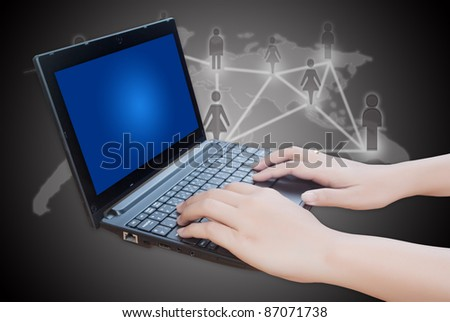 Hand pushing laptop keyboard with social network. - stock photo